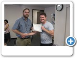 Andrew presenting Tim with his certificate for completion of the 8-week Peer Counseling class